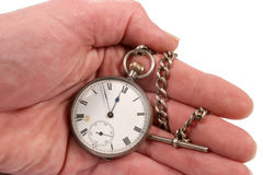 Pocket watch in hand. Antique pocket watch in hand against white Stock Photography