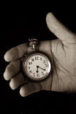 Pocket watch in hand. Hold look time detail duotone Royalty Free Stock Photos