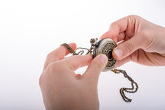 Pocket watch in hand Royalty Free Stock Images