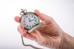 Pocket watch in hand Stock Photo