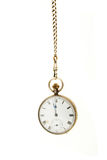 Pocket watch hanging from a chain Stock Images