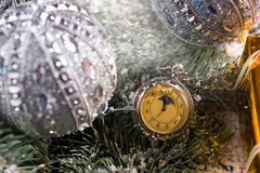 Pocket Watch Hanging on Decorated Evergreen. Close Up of Old Fashioned Pocket Watch Hanging on Snow Covered Sprigs of Evergreen Tree Decorated with Sparkling Stock Photography