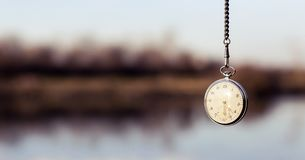 Pocket watch hanging from sky. Above Royalty Free Stock Images
