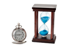 Pocket watch and hourglass Stock Photography