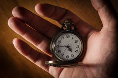 Pocket watch in human hand. Stock Photo