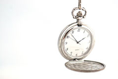 Pocket Watch indicating the importance of time. Time is an essence and the watch is the tool to tell if anything has changed Stock Photo