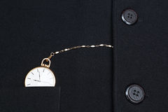 Pocket watch in the jacket businessman. Royalty Free Stock Photography