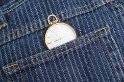 Pocket watch in a jeans pants. Stock Images