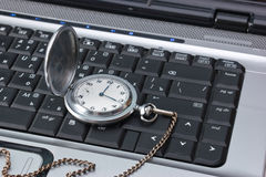 Pocket watch on a keyboard Royalty Free Stock Image