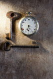 Pocket-watch and keys Stock Images