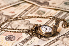 Pocket watch lie on dollars Stock Photography