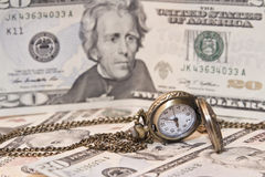 Pocket watch lie on dollars Royalty Free Stock Photos
