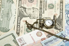 Pocket watch lie on dollars Royalty Free Stock Photo