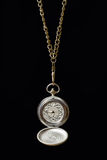 Pocket watch on a long chain. Royalty Free Stock Image
