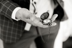 Pocket watch in a man`s hand royalty free stock images