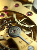 Pocket watch mechanism. Macro photo of pocket watch mechanism Stock Images