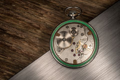 Pocket watch mechanism on abstract background Royalty Free Stock Photos