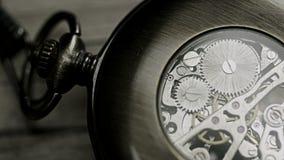 Pocket watch mechanism. Close up shot of a pocket watch mechanism stock video footage