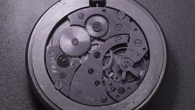 Pocket watch mechanism closeup stock footage