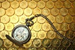 Pocket watch on money Stock Image