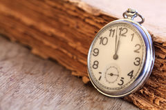Pocket watch next to book Royalty Free Stock Photography