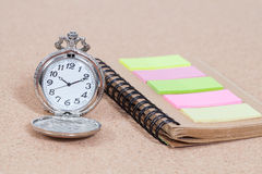 Pocket watch and note book Stock Images