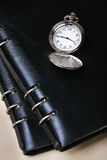 Pocket watch with  notebook Stock Photography