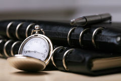 Pocket watch with  notebook Royalty Free Stock Images