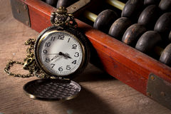 Pocket watch with old abacus Stock Images
