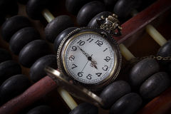 Pocket watch with old abacus,vintage color Stock Photography