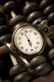 Pocket watch with old abacus Stock Photos