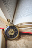 Pocket Watch with Old Books on Crumpled Paper in Vintage Tone Royalty Free Stock Images