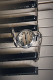 Pocket watch on old keyboard piano Royalty Free Stock Photos