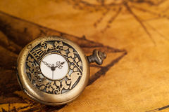 Pocket watch on old map background,. Vintage style light and tone Royalty Free Stock Photography