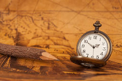 Pocket watch on old map background,. Vintage style light and tone Royalty Free Stock Photos