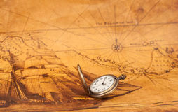 Pocket watch on old map background,. Vintage style light and tone Stock Photography