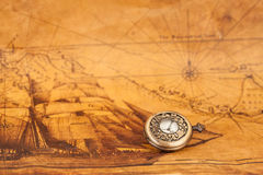 Pocket watch on old map background, vintage. Style light and tone Royalty Free Stock Photography