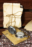 Pocket watch and old photos Royalty Free Stock Images