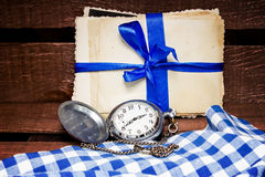 Pocket watch and old photos Stock Photo