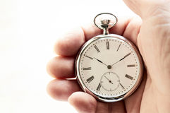 Pocket watch, Old style marks the passage of time. In the foreground Stock Photography