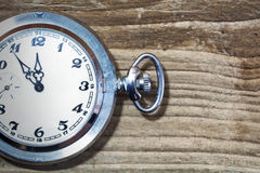 Pocket watch on old wood Stock Photography