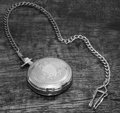Pocket watch. Old pocket watch on the wooden background Stock Images