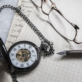 Pocket Watch On Old Paper Background Stock Photography