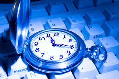 Pocket Watch On The Keyboard Royalty Free Stock Images