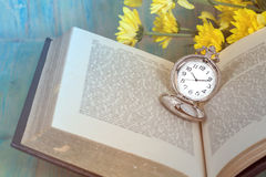 Pocket Watch over Age Book Background ,Time Royalty Free Stock Images