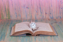 Pocket Watch over Age Book Background ,Time Royalty Free Stock Image
