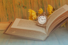 Pocket Watch over Age Book Background ,Time Stock Photo
