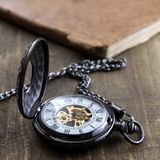 Pocket watch over grunge wooden table Stock Images