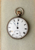 Pocket watch on paper Stock Image