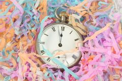Pocket watch with party streamers Royalty Free Stock Image